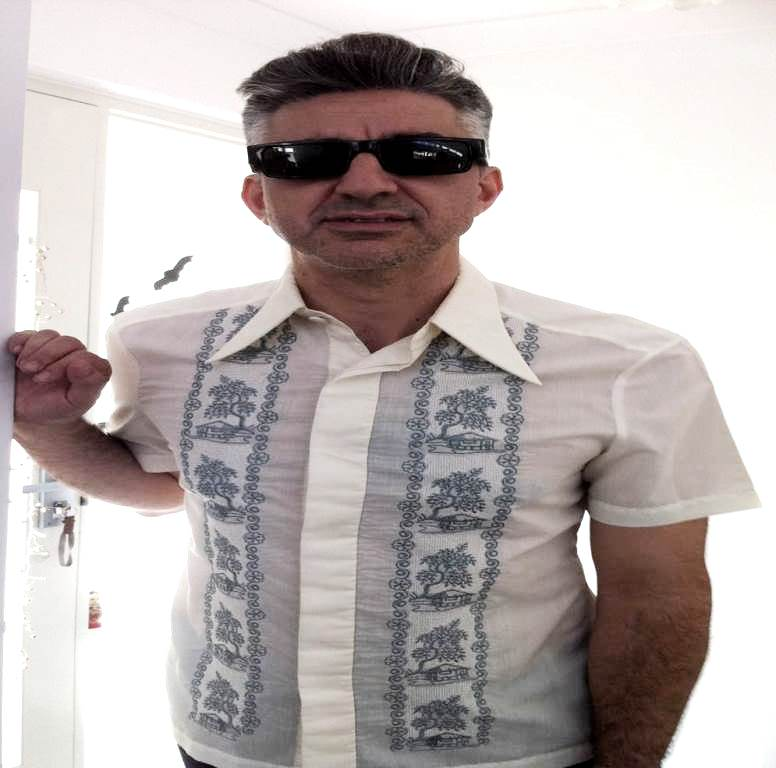Steve from Surf Mist enjoys his Tiki Shirt from the Tiki Queen!